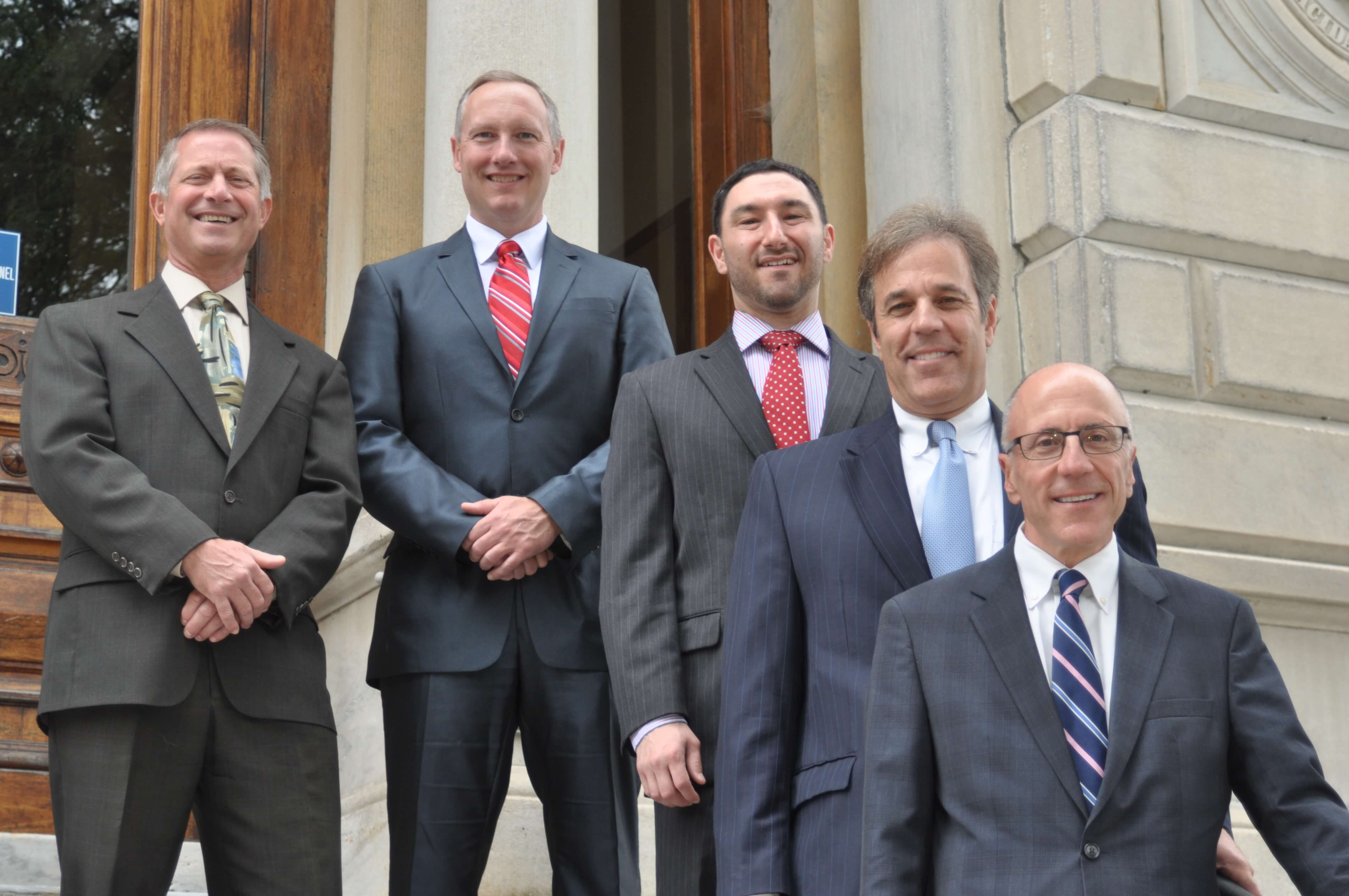 Attorney Robert Monteleone, Jr., Scott Ellis, Matt Mozian, Peri Campoli, Thomas Campoli outside the courthouse in Pittsfield, MA
